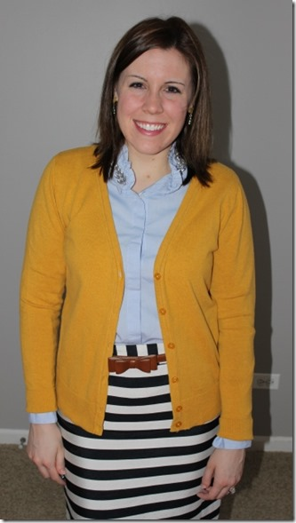 close up: mustard cardigan, jeweled oxford button up, black white striped skirt, cognac belt and boots, texctured tights