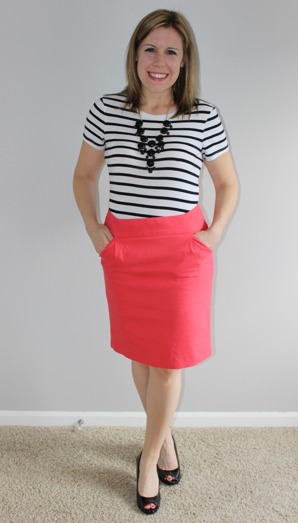 Coral pencil skirt, black and white striped tee, black statement necklace, black peep toe heels