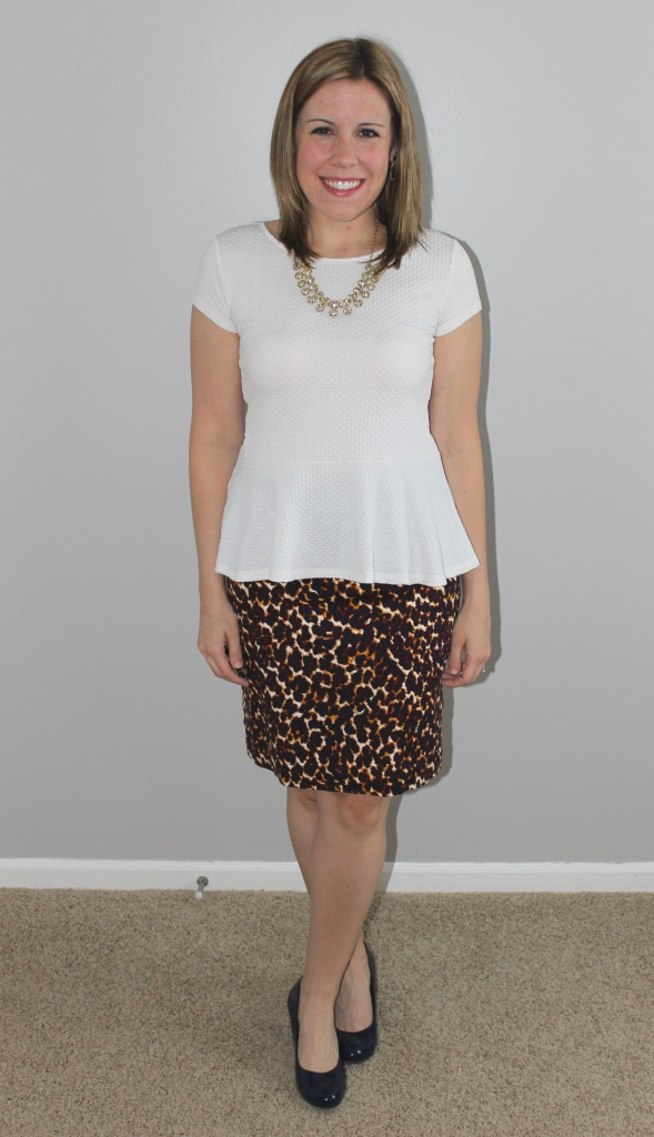 Leopard print skirt, white peplum top, navy heels