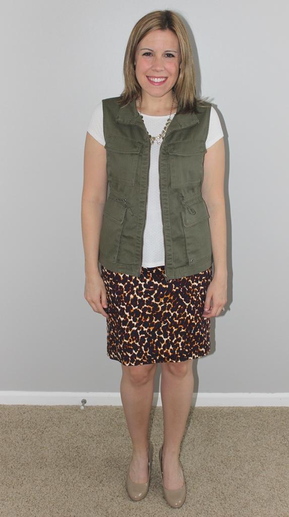 Leopard print skirt, white peplum top, cargo vest, nude heels