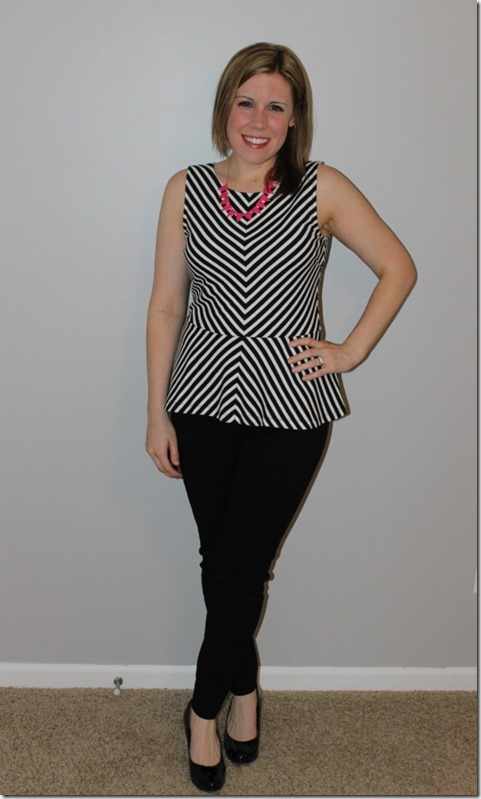 black and white peplum, black pants, pink statement necklace