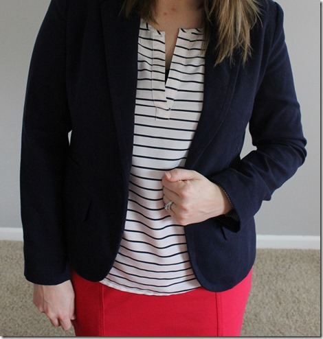 Close up: Navy blazer, white striped blouse, pink pencil skirt