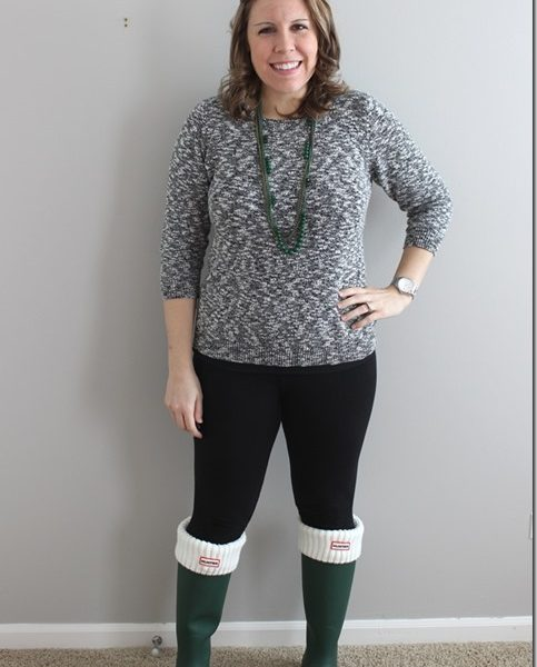 green hunter boots, black leggings, black and white marbled sweater, green necklace