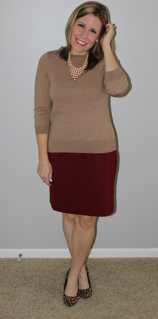 sweater over a maroon dress